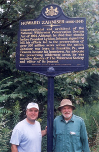 Zahniser's son Matt and grandson David in front of Zahniser historical marker